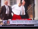 Aaron Hernandez in hand cuffs