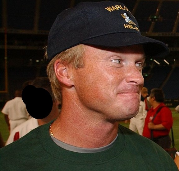 030801-N-9849W-001  Tokyo, Japan (Aug. 1, 2003) -- Cmdr. Brian Corey, Executive Officer of the ÒGolden DragonsÓ of Strike Fighter Squadron One Ninety Two (VFA-192), discusses coaching strategies in the Tokyo Dome with Head Coach John Gruden of the National Football League (NFL) Tampa Bay Buccaneers.  Personnel assigned to Carrier Air Wing Five (CVW-5) were invited to the dome to meet with the players of both the Tampa Bay Buccaneers and The New York Jets.  Both teams will meet in tomorrowÕs Tokyo Bowl for a preseason National Football League (NFL) game.  U.S. Navy photo by PhotographerÕs Mate 3rd Class John E. Woods.  (RELEASED)